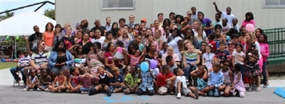 Branches congregation in front of portable building